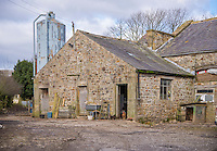 Lancashire farmyard with feed bin and stone buildings, Chipping, Lancashire.
