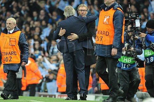 12.04.2016. manchester, England. UEFA Champions league, quarterfinals, second leg. Manchester City versus Paris St Germain.  LAURENT BLANC (ENTRAINEUR PSG) hugs Manuel Pellegrini (TRAINER MANCHESTER CITY) at game end