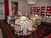 """The 2018 White House Christmas decorations, with the theme """"American Treasures"""" which were personally selected by first lady Melania Trump, are previewed for the press in Washington, DC on Monday, November 26, 2018. In the China Room, also known as the Dish Room, with place settings on display for the holidays.  <br /> Credit: Ron Sachs / CNP"""