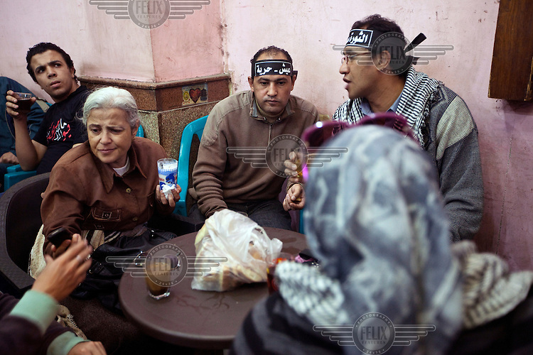 Protesters who have come from a rally in Tahrir Square talk, rest and drink tea at the Zahrat al-Bustan cafe. /Felix Features