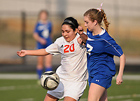 NWA Democrat-Gazette/BEN GOFF @NWABENGOFF<br /> Amy Perez (20) of Rogers Heritage and Sienna Nealon (17) of Rogers chase the ball Friday, March 17, 2017, during the game in Gates Stadium at Rogers Heritage.
