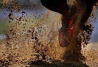 "Ryan Edwards, of Southeast High School, tramples through the sand pit as he lands after his long jump attempt at the Illinois Boys State Track Meet. kpgec ""Sandy Finish"""