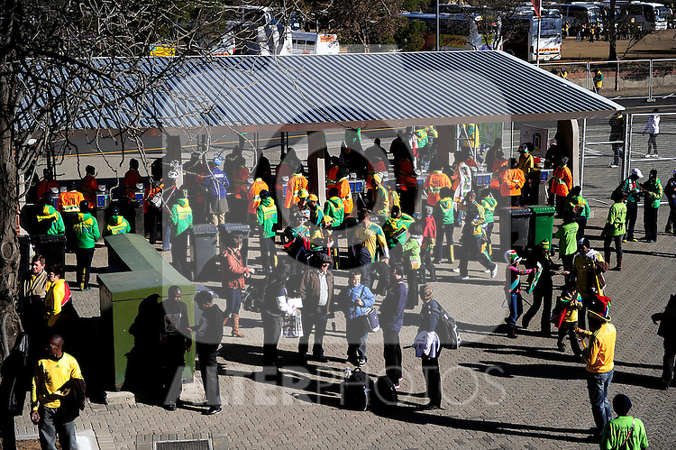 Spectators getting into the stadium before  the 2010 World Cup Soccer match between South Africa and France played at the Freestate Stadium in Bloemfontein South Africa on 22 June 2010.