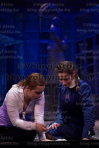Actresses Zsuzsi Vago (L) and Bernadett Vago (R) both perform the role of Georgina Vitay on stage together during a dress rehearsal of the new musical piece by Hungary's Operette Theatre based on a novel titled matching the novel Abigel by famous Hungarian writer Magda Szabo. Budapest, Hungary. Wendesday, 21. March. 2008. ATTILA VOLGYI