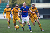 Jason Kennedy of Carlisle under pressure from Sean Rigg and Ben Tozer of Newport County during the Sky Bet League 2 match between Newport County and Carlisle United at Rodney Parade, Newport, Wales on 12 November 2016. Photo by Mark  Hawkins.