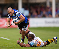 Bath Rugby's Jonathan Joseph is tackled by Wasps' Gaby Lovobalavu<br /> <br /> Photographer Bob Bradford/CameraSport<br /> <br /> Premiership Rugby Cup - Bath Rugby v Wasps - Sunday 5th May 2019 - The Recreation Ground - Bath<br /> <br /> World Copyright © 2018 CameraSport. All rights reserved. 43 Linden Ave. Countesthorpe. Leicester. England. LE8 5PG - Tel: +44 (0) 116 277 4147 - admin@camerasport.com - www.camerasport.com
