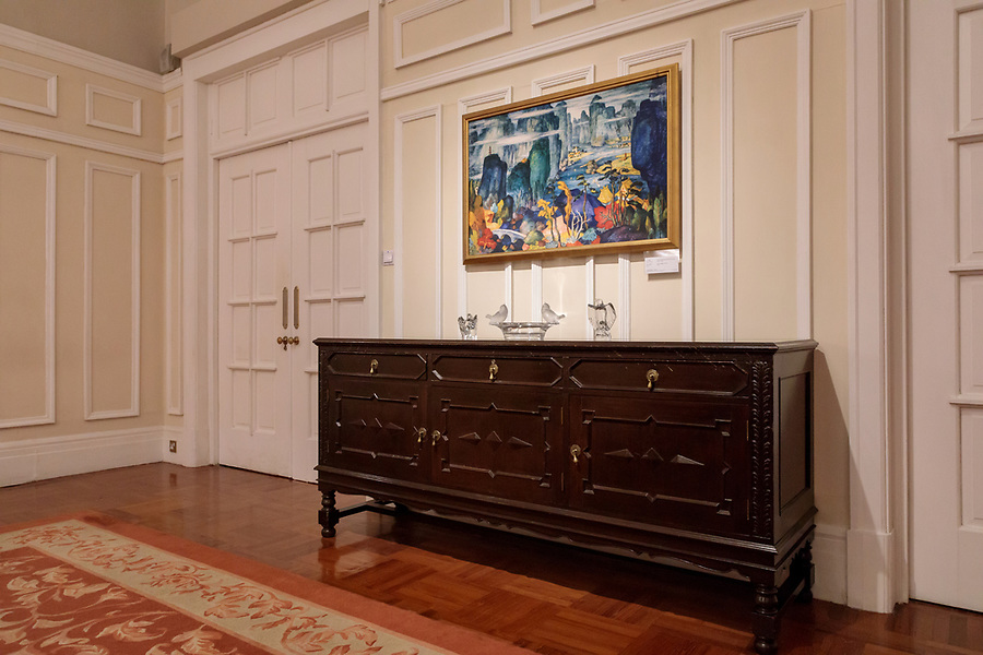 Chest and painting at the rear of the Dining Room.