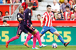 Sporting de Gijon's Burgui (r) and FC Barcelona's Rafinha Alcantara (l) and Gerard Pique during La Liga match. September 24,2016. (ALTERPHOTOS/Acero)