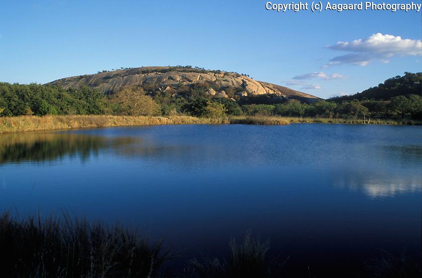Enchanted Rock from Moss Lake.