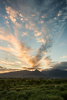 Dramatic sunset and clouds above the West Maui Mountains, as seen from central Maui.