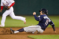 Nick Van Stratten (11) of the Northwest Arkansas Naturals slides into second base during a game against the Springfield Cardinals on May 13, 2011 at Hammons Field in Springfield, Missouri.  Photo By David Welker/Four Seam Images.