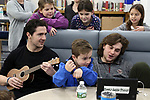 Students from the Mansquan Elementary School take a tour of Manasquan High School. Jake Busco (center) listens as D.J. De Somma (left) and Luke Morgan (right) teach the students a song during their tour.<br /> (3/29/18)<br /> (MARK R. SULLIVAN /THE COAST STAR)