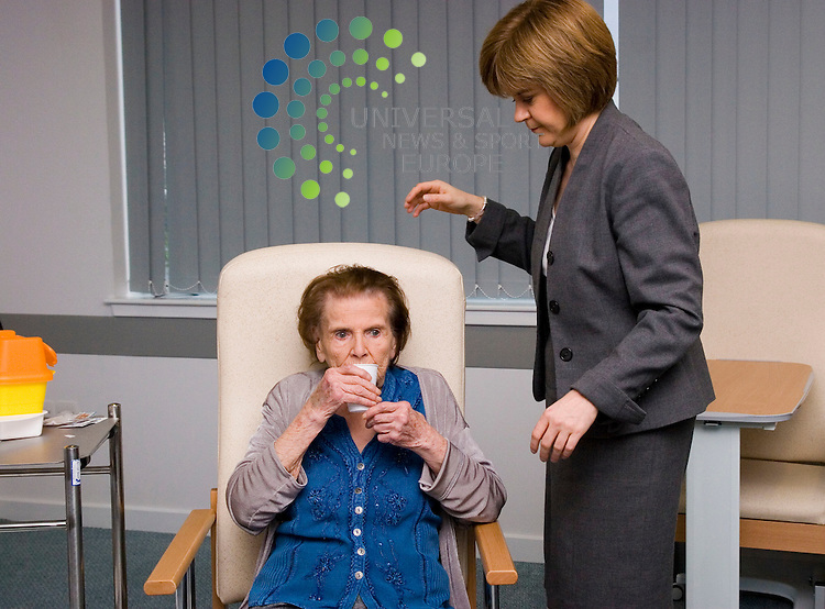Scotland's first recipient of the H1N1 pandemic vaccination(swine flu) 84 year old Adeline Miskelly is pictured with Rhona Wall nurse who administered the life saving jab and Scottish health secretary Nicola Sturgeon at Glasgow's new Victoria Hospital  .Picture Johnny Mclauchlan/Universal news and Sport (Scotland)21/10/09