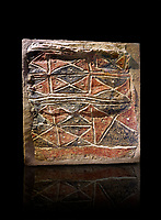 Wall fresco of geometric red and black triangles which appears to be a rug pattern copy. 6000 BC. . Catalhoyuk Collections. Museum of Anatolian Civilisations, Ankara. Against a black background