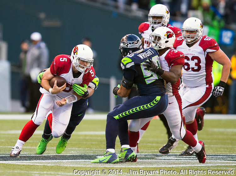 Arizona Cardinals quarterback Drew Stanton (5) is sacked Seattle Seahawks defensive tackle Jordan Hill (97) at CenturyLink Field in Seattle, Washington on November 23, 2014. Stanton completed 14 of 26 passes for 149 yards and had one interception in the Cardinals 3-19 loss to the Seahawks.     ©2014. Jim Bryant Photo. All Rights Reserved.