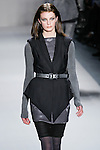 Diana Moldovan walks the runway in a Nicole Miller Fall 2011 outfit, during Mercedes-Benz Fashion Week.