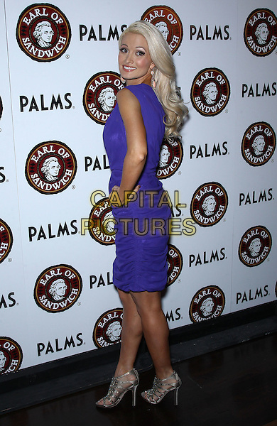 Holly Madison.Earl of Sandwich Grand Opening Celebration with Holly Madison at The Palms Casino Resort,  Las Vegas, Nevada, USA..July 2nd, 2012.full length purple one shoulder dress hand on hip silver open toe shores sandals side looking over shoulder .CAP/ADM/MJT.© MJT/AdMedia/Capital Pictures.