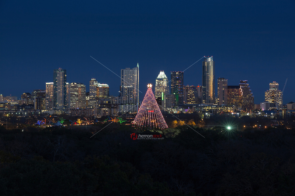 Austin celebrates Christmas with the Zilker Holiday Tree and Trail of Lights overlooking the Austin skyline.
