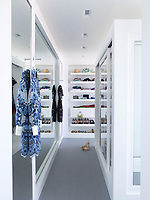 The luxurious master bedroom has a dressing room with cabinetry crafted from Corian.