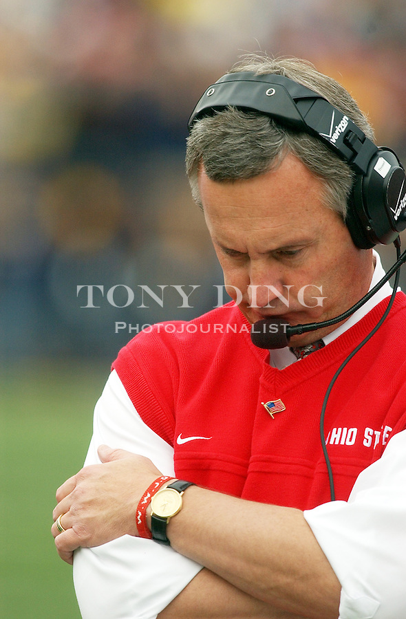 Buckeyes head coach Jim Tressel is down during the Wolverine's 35-21 upset of Ohio State on Saturday, November 22, 2003 in Ann Arbor, Mich. This was the 100th rivary match between UM and OSU. (TONY DING/The Michigan Daily)
