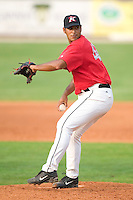 Kannapolis Intimidators relief pitcher Alex Farfan winds up to deliver the ball to the plate versus the Greenville Drive at Fieldcrest Canon Stadium in Kannapolis, NC, Sunday, July 9, 2006.