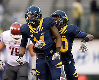 Chris McCain of California celebrates with Cecil Whiteside of California after Whiteside sacked Washington State quarterback Marshall Lobbestael during the game at AT&T Park in San Francisco, California on November 5th, 2011.  California defeated Washington State, 30-7.