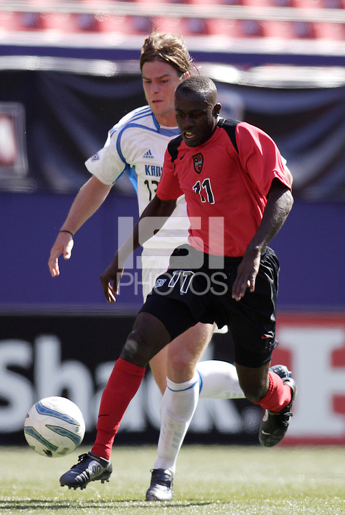 """The MetroStars' Abdoulaye """"Abbe"""" Ibrahim is chased by Dustin Branan of the Wizards. The MetroStars and the Kansas City Wizards reserve squads played to a scoreless tie in their first MLS reserve league game at Giant's Stadium, East Rutherford, NJ, on Sunday April 17, 2005."""