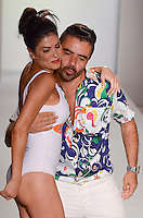 Real Housewives of Miami, Adriana De Moura and Designer AZ Araujo walk runway at A.Z Araujo Swimwear Show during Mercedes Benz IMG Fashion Swim Week 2013 at The Raleigh Hotel, Miami Beach, FL on July 23, 2012