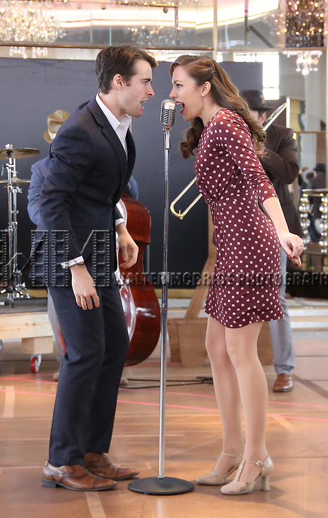 Corey Cott and Laura Osnes perform during the 'Bandstand' Broadway cast press presentation at the Rainbow Room on March 7, 2017 in New York City.
