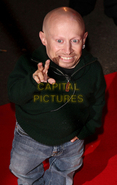 VERNE TROYER .Celebrity Big Brother housemates enter The House Elstree Studios, Borehamwood, Hertfordshire (Herts), England, 2nd January 2009..half length v peace sign hand gesture black sweater jumper top little person  mini me mini-me dwarf jeans 3/4.CAP/ROS.©Steve Ross/Capital Pictures