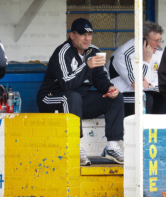 Craig Levein enjoying a cup of tea and a biscuit