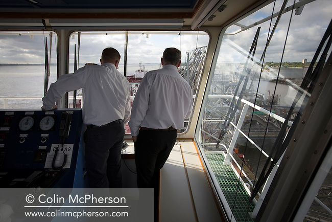 Martin Baxter (right) of the Liverpool Pilotage Service on the bridge of an oil tanker as he pilots the boat into its berth. Baxter and his colleague Dave Williamson navigated the tanker from Anglesey to the river Mersey, where it berthed at Tranmere Oil Terminal to discharge its cargo. The Liverpool Pilotage service celebrated its 250th anniversary in 2016.