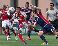 Portland Timbers midfielder/defender Rodney Wallace (22) collects a pass as New England Revolution forward Blake Brettschneider (23) closes. In a Major League Soccer (MLS) match, the New England Revolution defeated Portland Timbers, 1-0, at Gillette Stadium on March 24, 2012