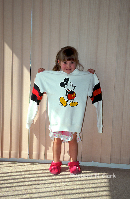 Girl showing off her Mickey sweatshrit