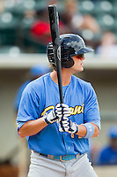 Myrtle Beach Pelicans first baseman Trever Adams (14) at bat against the Winston-Salem Dash at BB&T Ballpark on July 7, 2013 in Winston-Salem, North Carolina.  The Pelicans defeated the Dash 6-5 in 8 innings in game two of a double-header.  (Brian Westerholt/Four Seam Images)