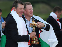 Lee Westwood (EUR) and Jamie Donaldson (EUR) pose for final pictures as Europe win the 2014 Ryder Cup from Gleneagles, Perthshire, Scotland. Picture:  David Lloyd / www.golffile.ie