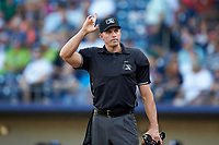 Home plate umpire Shane Livensparger indicates there is one warm-up pitch left during the International League game between the Scranton/Wilkes-Barre RailRiders and the Gwinnett Stripers at Coolray Field on August 17, 2019 in Lawrenceville, Georgia. The Stripers defeated the RailRiders 8-7 in eleven innings. (Brian Westerholt/Four Seam Images)