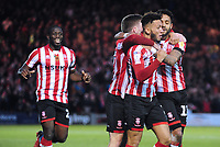 Lincoln City's Kellan Gordon celebrates scoring his side's second goal with team-mates<br /> <br /> Photographer Andrew Vaughan/CameraSport<br /> <br /> The EFL Sky Bet League Two - Lincoln City v Forest Green Rovers - Saturday 3rd November 2018 - Sincil Bank - Lincoln<br /> <br /> World Copyright &copy; 2018 CameraSport. All rights reserved. 43 Linden Ave. Countesthorpe. Leicester. England. LE8 5PG - Tel: +44 (0) 116 277 4147 - admin@camerasport.com - www.camerasport.com