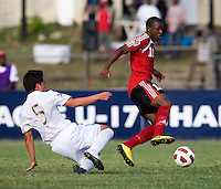 Julio Ortiz (5) of Guatemala tries to tackle Jomal Williams (10) of Trinidad & Tobago  during the group stage of the CONCACAF Men's Under 17 Championship at Jarrett Park in Montego Bay, Jamaica. Trinidad & Tobago defeated Guatemala, 1-0.