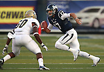 Nevada quarterback Cody Fajardo scrambles past UC Davis defender Walter Earnest during the first half of a college football game in Reno, Nev., on Saturday, Sept. 7, 2013. (AP Photo/Cathleen Allison)