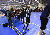 15 MAR 2014 - BIRMINGHAM, GBR - Dead Hardy of Power or Scotland celebrates as he exits the tunnel formed by spectators and officials after the teams bout against Team USA at the inaugural Men's Roller Derby World Cup in the Futsal Arena in Birmingham, West Midlands, Great Britain (PHOTO COPYRIGHT © 2014 NIGEL FARROW, ALL RIGHTS RESERVED)