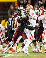 The tenth ranked South Carolina Gamecocks host the 6th ranked Clemson Tigers at Williams-Brice Stadium in Columbia, South Carolina.  USC won 31-17 for their fifth straight win over Clemson.  South Carolina Gamecocks defensive end Jadeveon Clowney (7) almost sacks Clemson Tigers quarterback Tajh Boyd (10)
