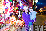 Margaret Coffey and her son Michael Anthony admire a Christmas display while Christmas Shopping in Castleisland on Monday