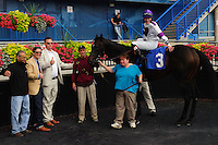So Long George (3) with jockey Emma-Jayne Wilson in the winners circle at Woodbine Race Course in Ontario, Canada on September 15, 2012.
