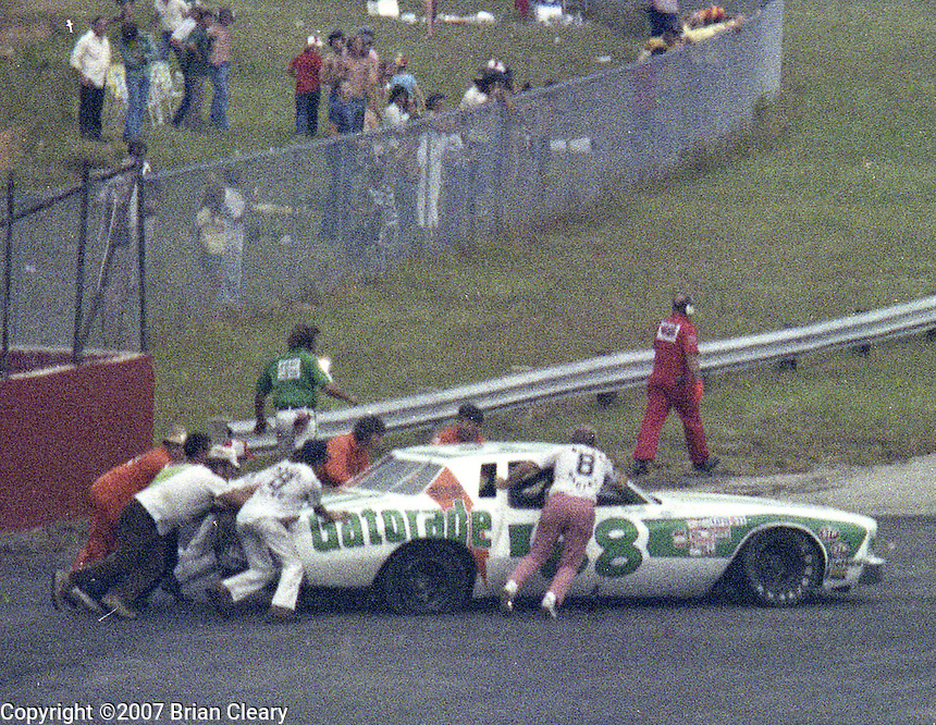 Darrell Waltrip #88 Chevrolet Monte Carlo crewmen help after crash 6th place finish Southern 500 Darlington Raceway, Darlington SC, September 5, 1977.(Photo by Brian Cleary/www.bcpix.com)