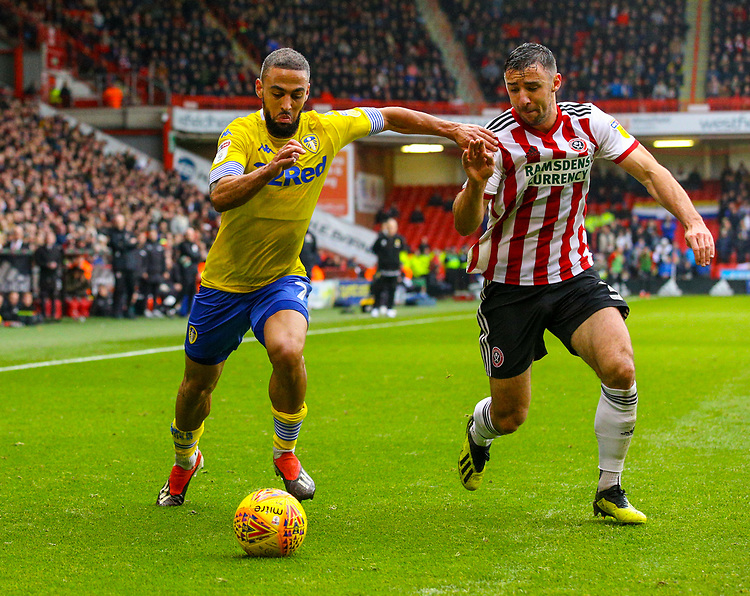 Leeds United's Kemar Roofe takes on Sheffield United's Enda Stevens<br /> <br /> Photographer Alex Dodd/CameraSport<br /> <br /> The EFL Sky Bet Championship - Sheffield United v Leeds United - Saturday 1st December 2018 - Bramall Lane - Sheffield<br /> <br /> World Copyright © 2018 CameraSport. All rights reserved. 43 Linden Ave. Countesthorpe. Leicester. England. LE8 5PG - Tel: +44 (0) 116 277 4147 - admin@camerasport.com - www.camerasport.com