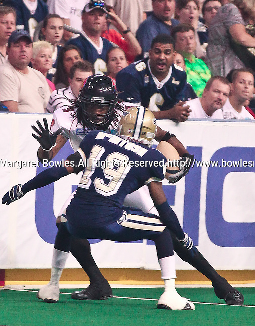 Aug 14, 2010: Orlando Predator wide receiver Bobby Sippio (#3) makes a touch catch against the wall as Tampa Bay Storm defensive back Erick McIntosh (#19) defends. The Storm defeated the Predators 63-62 to win the division title at the St. Petersburg Times Forum in Tampa, Florida. (Mandatory Credit:  Margaret Bowles)