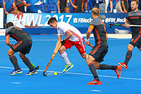 Phil Roper of England charges into the Netherlands D during the Hockey World League Semi-Final match between England and Netherlands at the Olympic Park, London, England on 24 June 2017. Photo by Steve McCarthy.