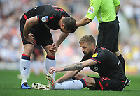 Bolton Wanderers' Andrew Taylor (left) checks in with injured team-mate Mark Beevers<br /> <br /> Photographer Kevin Barnes/CameraSport<br /> <br /> The EFL Sky Bet Championship - Blackburn Rovers v Bolton Wanderers - Monday 22nd April 2019 - Ewood Park - Blackburn<br /> <br /> World Copyright © 2019 CameraSport. All rights reserved. 43 Linden Ave. Countesthorpe. Leicester. England. LE8 5PG - Tel: +44 (0) 116 277 4147 - admin@camerasport.com - www.camerasport.com