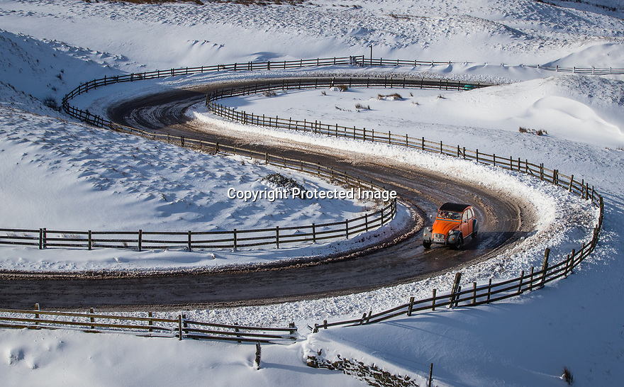 12/02/18<br /> <br /> A bright orange Citroen 2CV climbs up the road from Edale to Mam Tor near Castleton in the Derbyshire Peak District.<br /> <br /> All Rights Reserved F Stop Press Ltd. +44 (0)1335 344240 +44 (0)7765 242650  www.fstoppress.com
